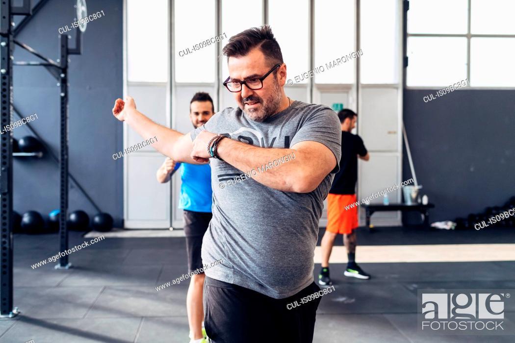 Stock Photo: Man exercising in gym.