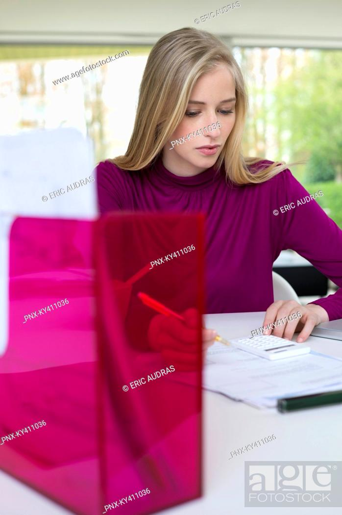 Stock Photo: Woman working in home office.