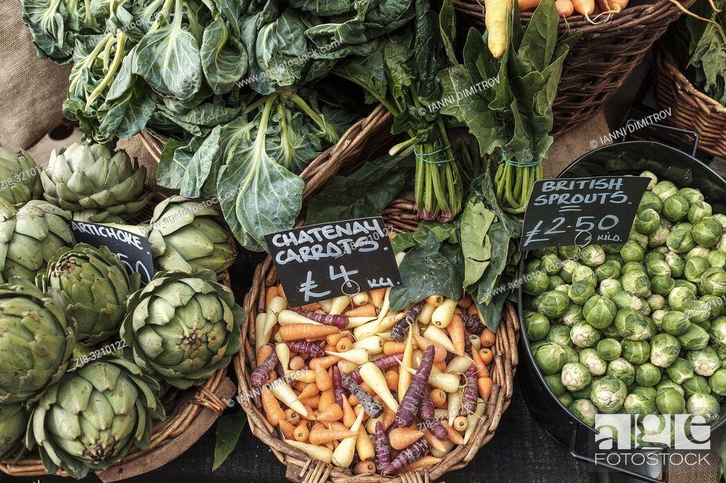 Stock Photo: England, London, Borough Market-Organic vegetables on display.