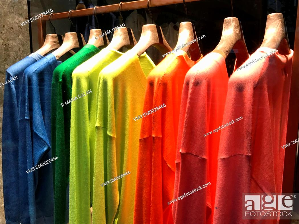 Stock Photo: Colorful jerseys in a shop window.