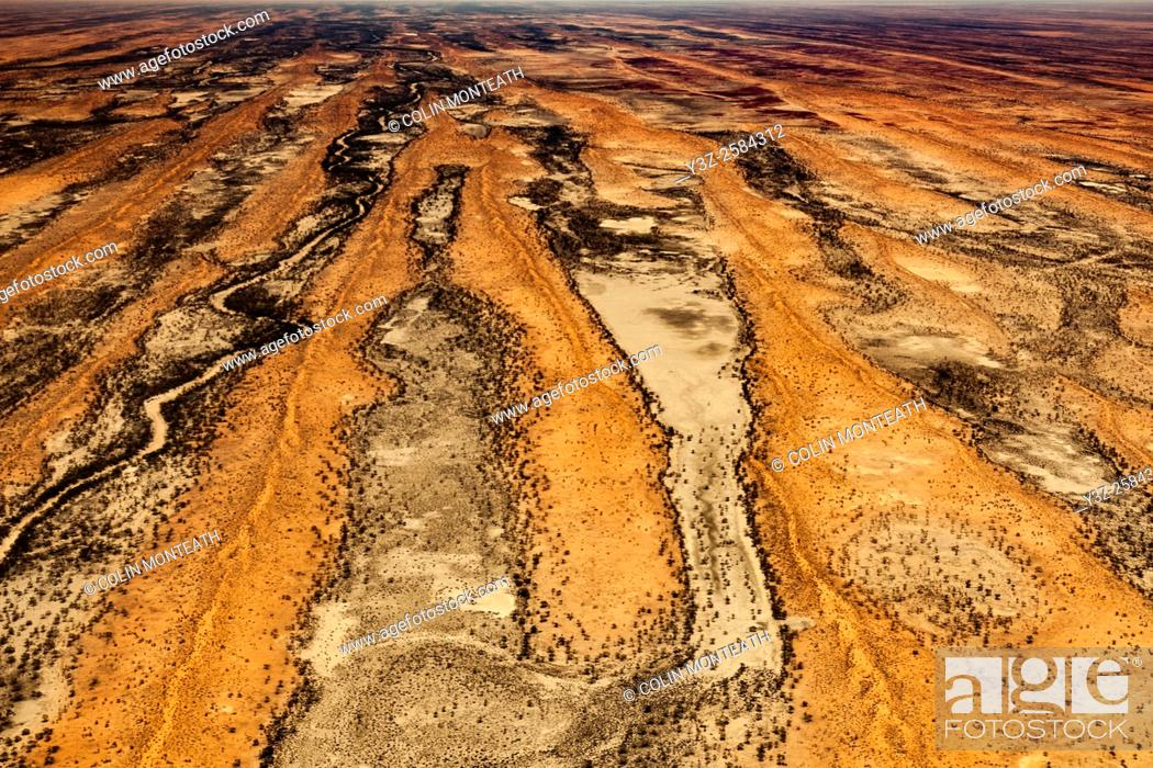 Stock Photo: Simpson desert sand dunes run parallel with each other, aerial view, Northern Territory & Queensland, Central Australia.
