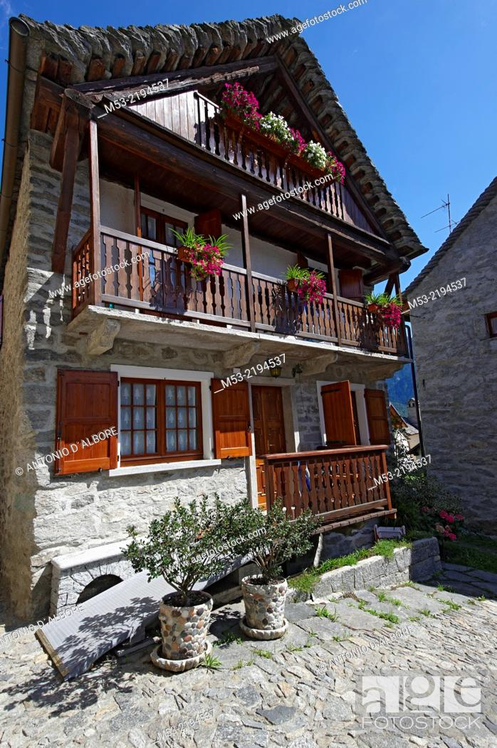 Stock Photo: A traditional alpine home made of stone and wood in Viceno di Crodo, a small village in Verbano-Cusio-Ossola Province. Piedmont. Italy.