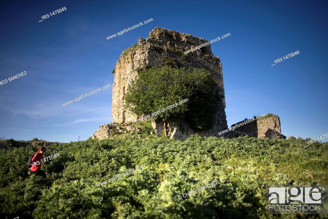 Stock Photo: A tourist walks among the ruins of the Fortress of Matrera, called Pajarete Hill, in Villamartin village, Cadiz Province, Spain, April 13.
