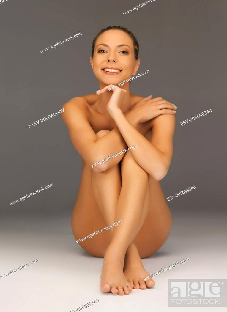 Stock Photo: picture of healthy naked woman over white.