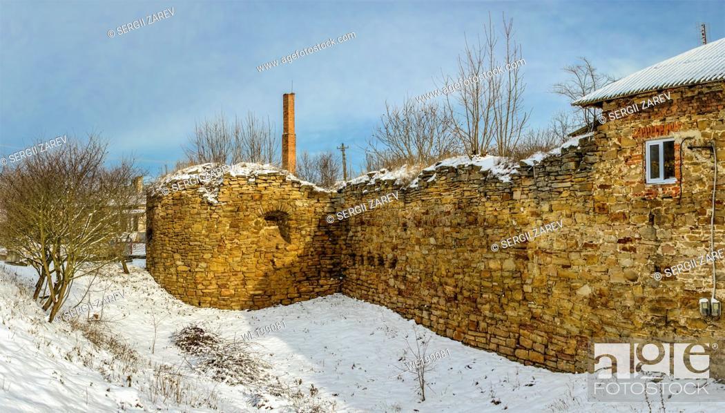 Stock Photo: Mykulyntsi, Ukraine 01. 06. 2020. The ruins of the old castle in the village of Mykulyntsi, Ternopil region of Ukraine, on a winter day.