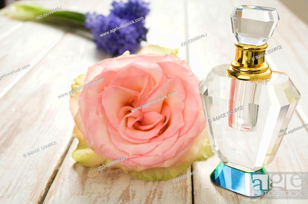 Stock Photo: Perfume and flowers.
