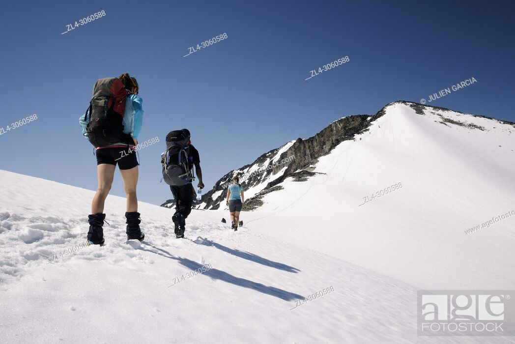 Stock Photo: Norway, Oppland, Vaga, Jotunheimen National Park, trekkers climbing Galdhopiggen, the tallest mountain in Norway and Scandinavia at 2469m.