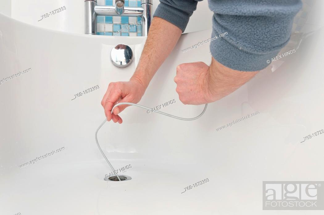 Stock Photo: Drain python tool for cleaning and unblocking sink drains.