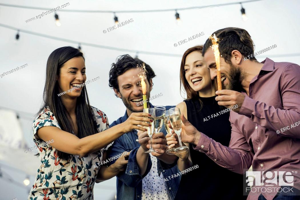 Photo de stock: Friends drinking champagne together outdoors.