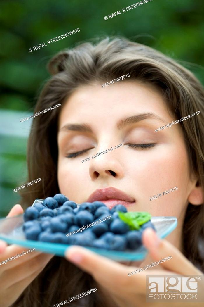 Stock Photo: Woman with berries.