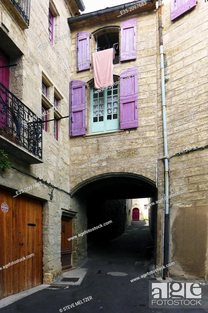 Stock Photo: archway apartment in the historic 14th century town of Pezenas, France.