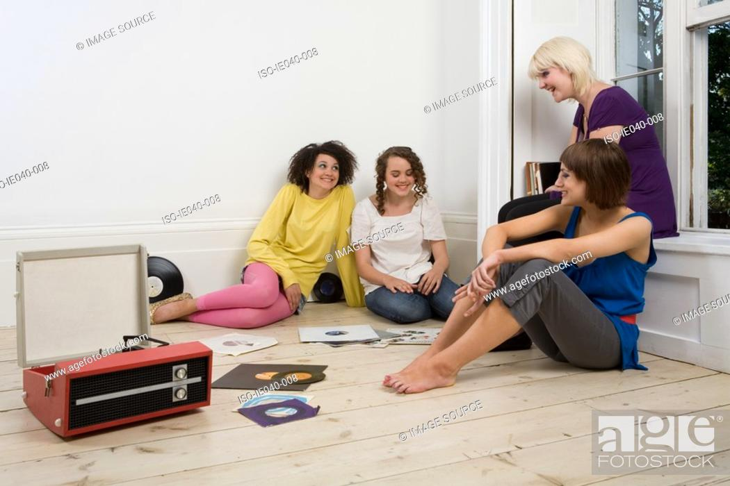 Stock Photo: Friends listening to music.