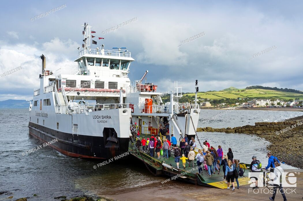 Stock Photo: Caledonian MacBrayne car ferry, that sails between the island of Millport and Largs, Ayrshire across the Firth of Clyde, berthed at the Largs slipway to allow.