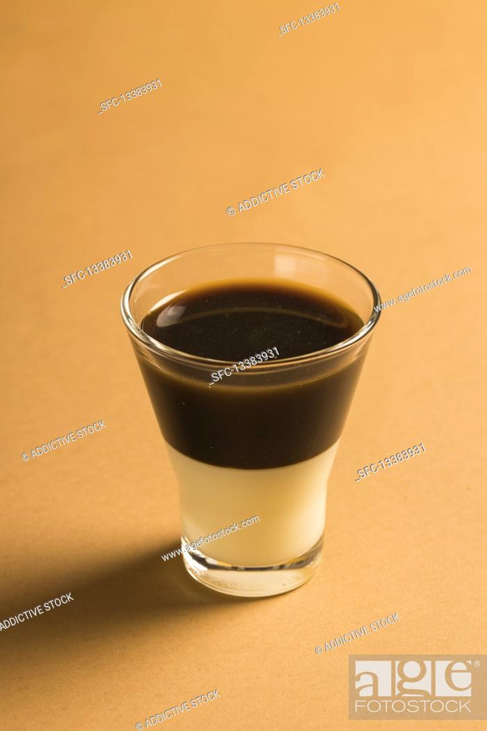 Stock Photo: Layered coffee Bombon drink with espresso and sweetened condensed milk.