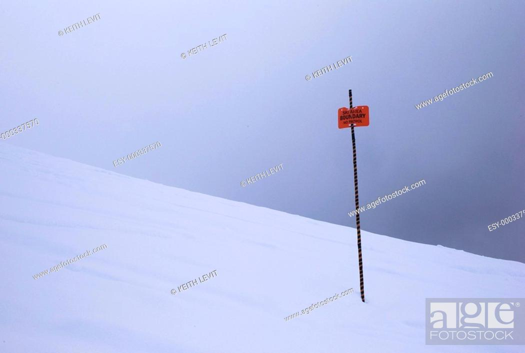 Stock Photo: Boundary sign in the snow.
