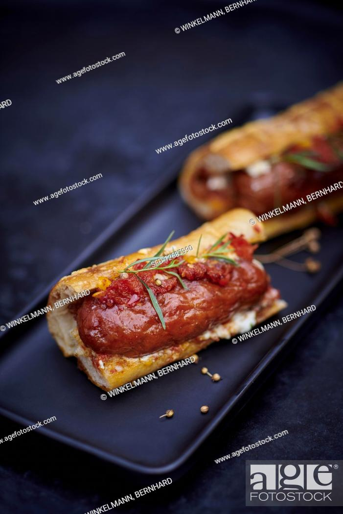 Stock Photo: Hot dog with tomato coulis.