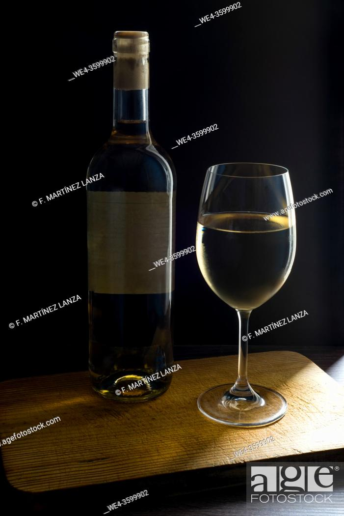 Photo de stock: Bottle and glass of white wine.