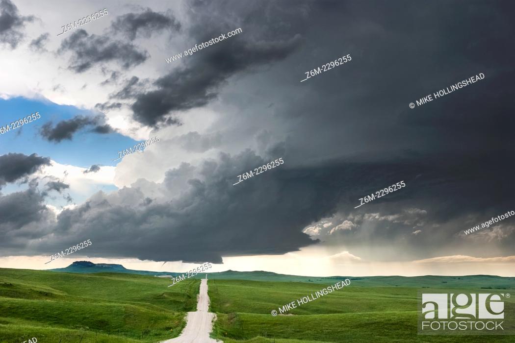 Stock Photo: Supercell storm with small tornado moves across the badlands area of southwest South Dakota near Kadoka, June 7, 2005.