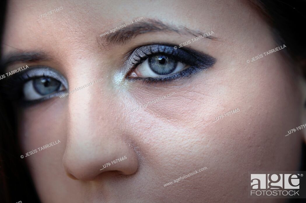 Stock Photo: Detail of the face of a young woman.
