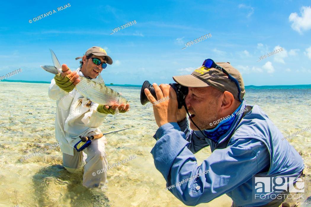 Stock Photo: Man holding Bonefish to Fishing Photo in los Roques - venezuela.