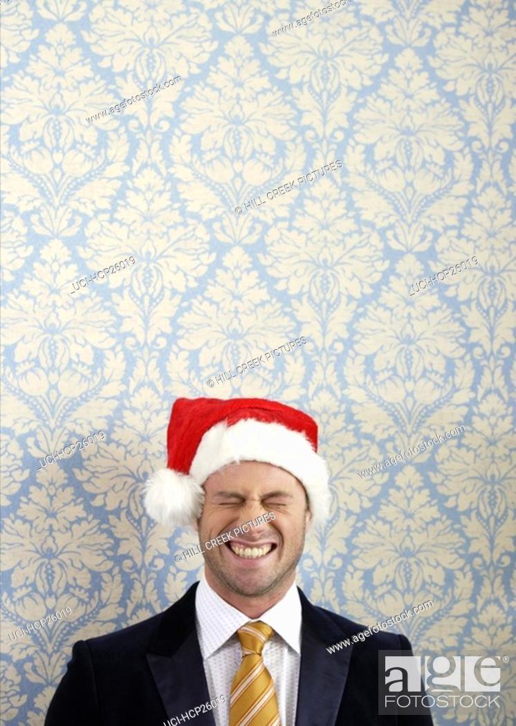 Stock Photo: Smiling man in Santa hat.