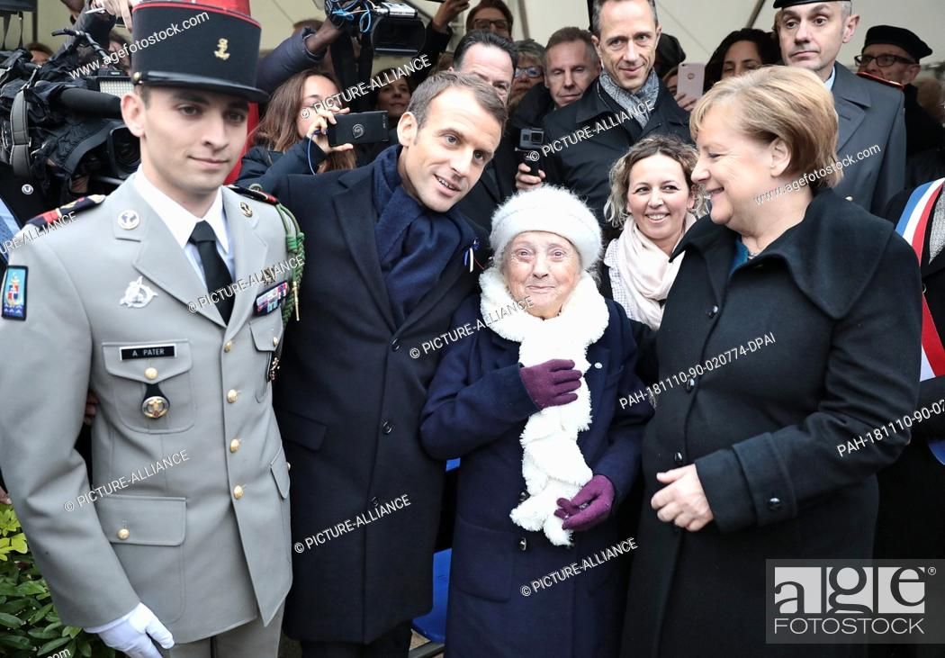 Stock Photo: 10 November 2018, France, Compiegne: German Chancellor Angela Merkel (CDU, r) and French President Emmanuel Macron (2nd from left) meet with representatives of.
