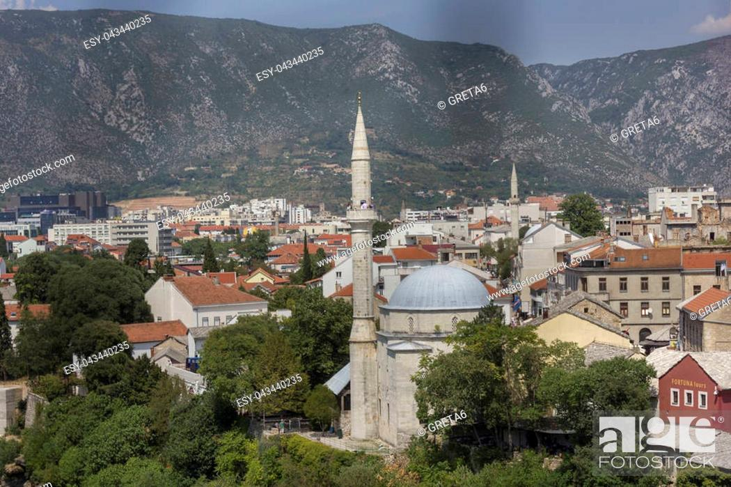 Stock Photo: View from the top of the city of Mostar, surrounded by mountains.