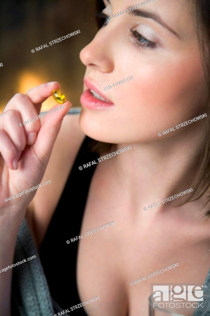 Stock Photo: woman taking medicine.