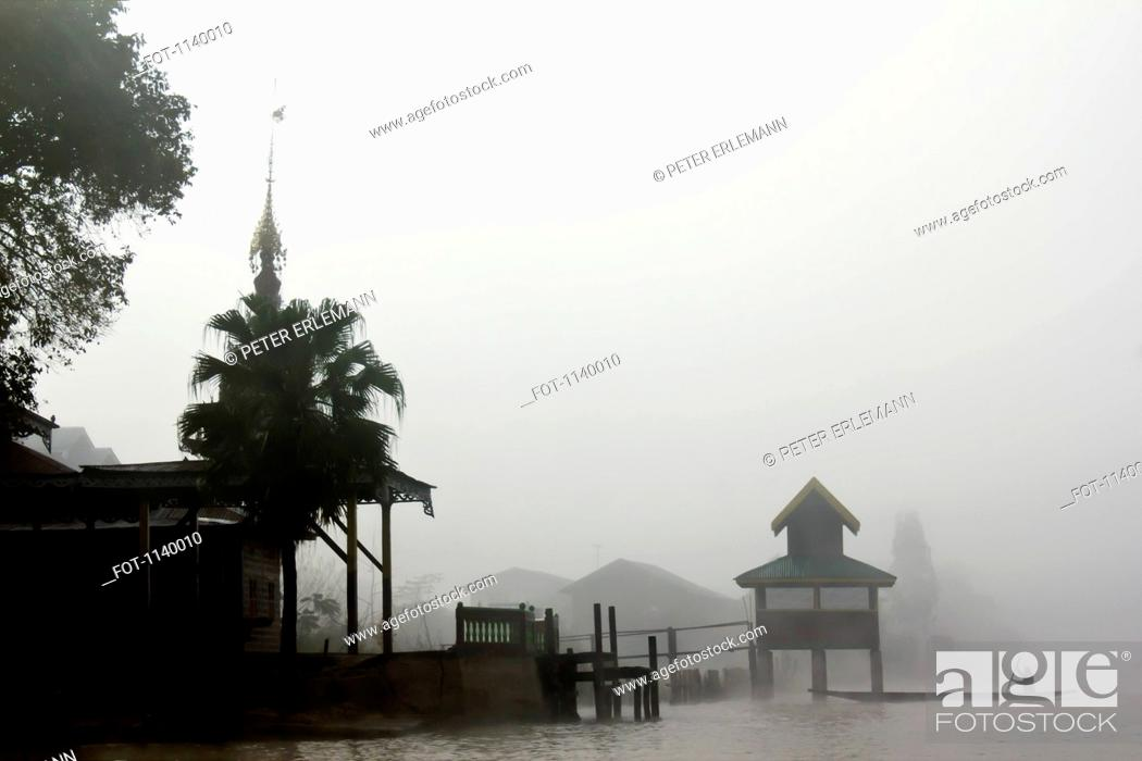 Stock Photo: Fog surrounding a village on Inle Lake, Burma.