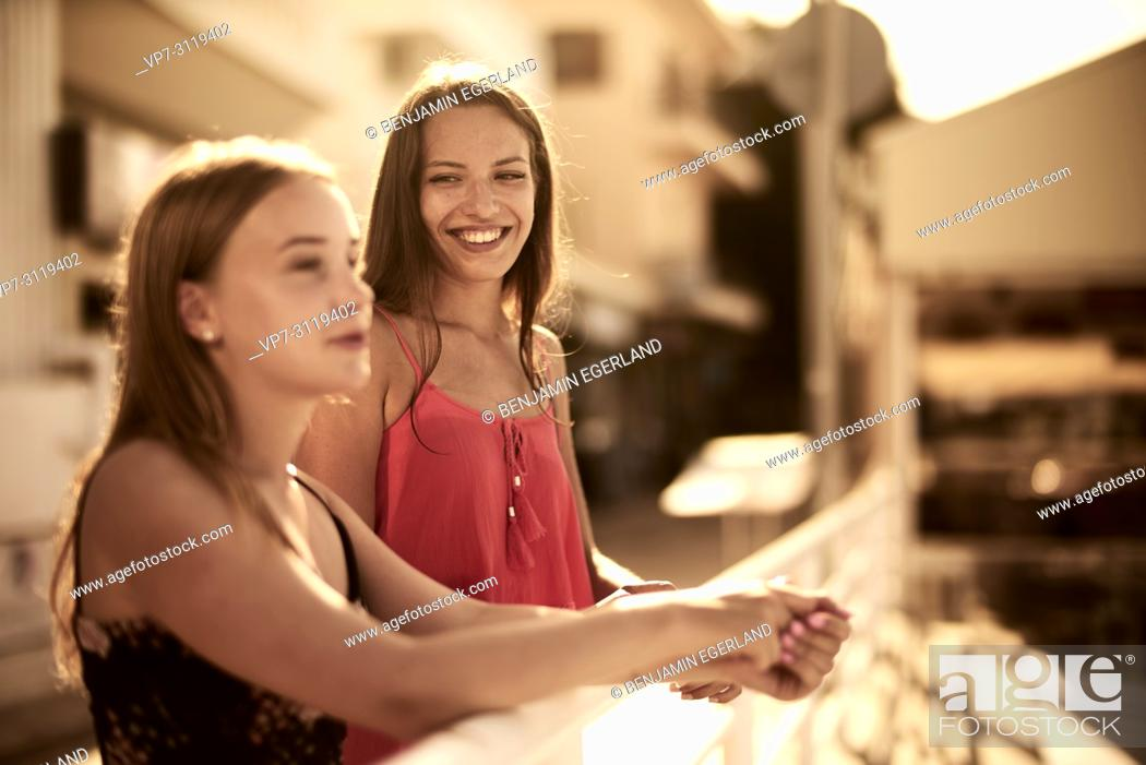 Stock Photo: two women, best friends, leaning on handrail. In holiday destination Chersonissos, Crete, Greece.