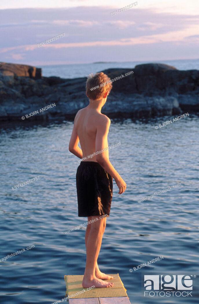 Stock Photo: Boy on springboard.