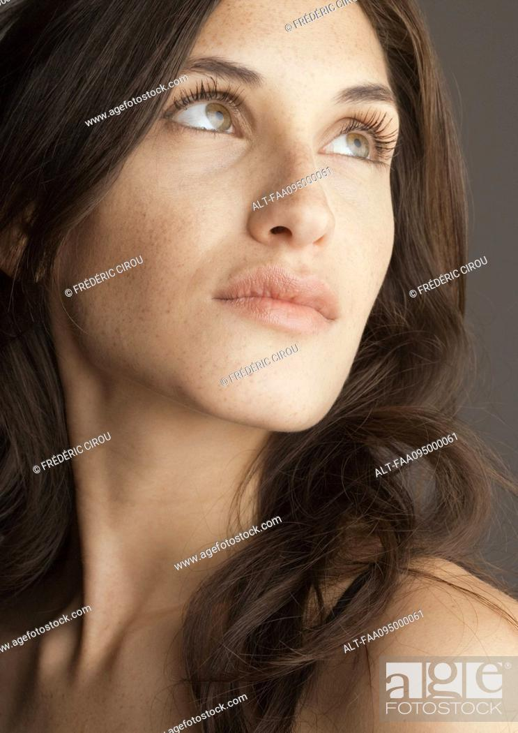 Stock Photo: Young woman, looking up, portrait.
