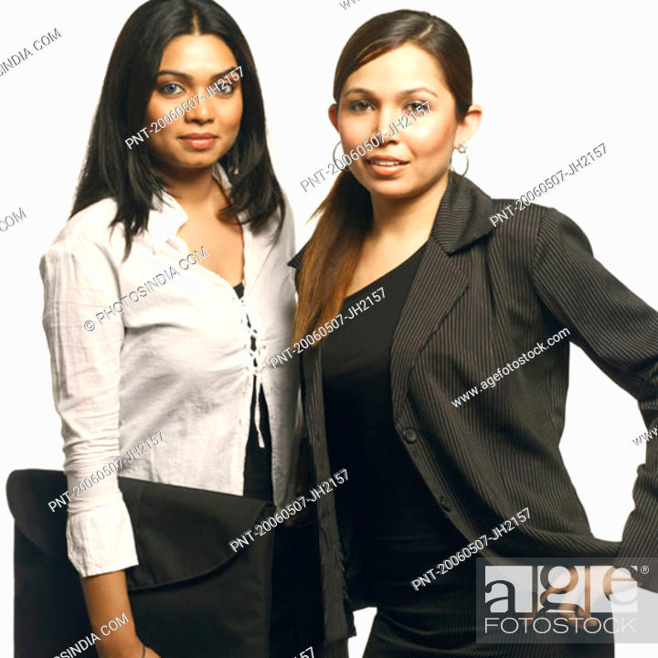 Stock Photo: Portrait of two businesswomen standing together.