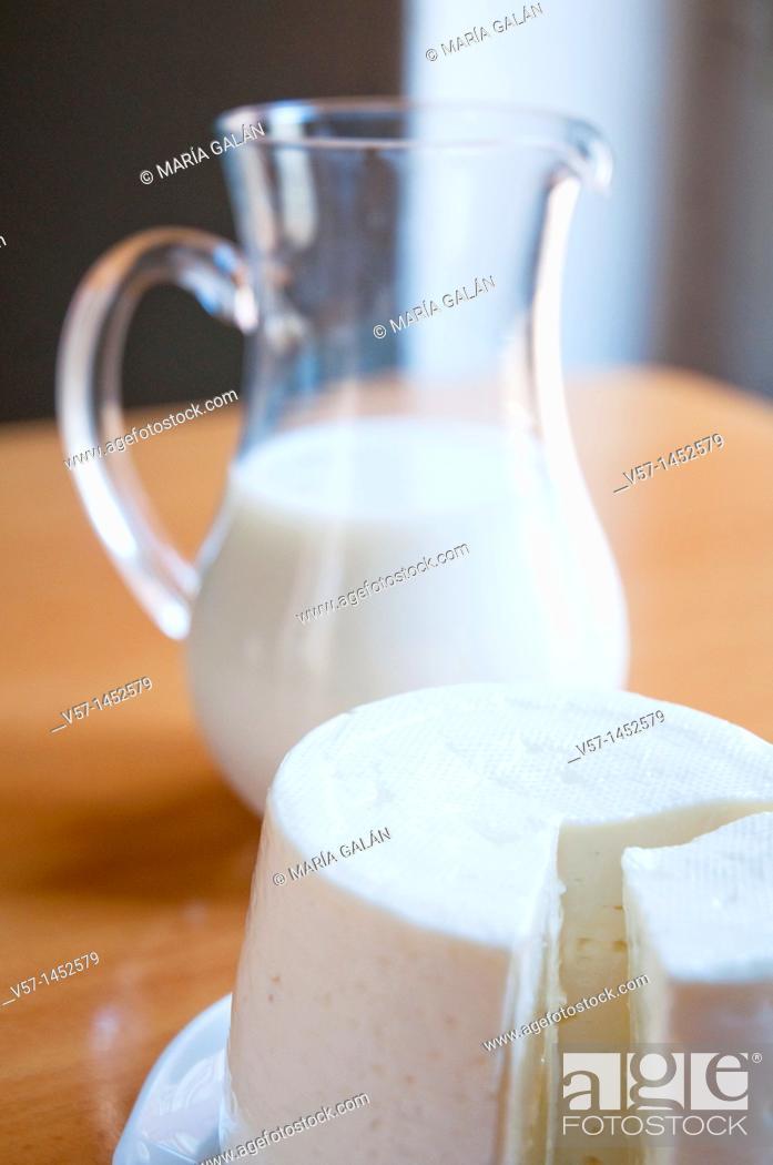 Stock Photo: Burgos cheese and jug of milk.