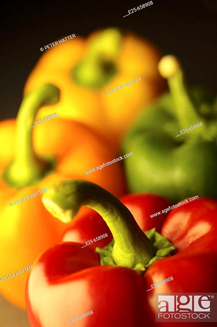 Stock Photo: Four peppers arranged in a studio-shot still life composition.