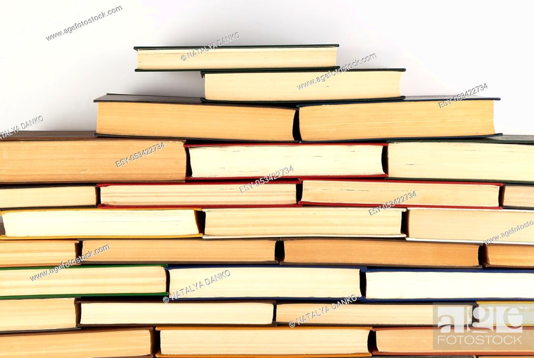 Stock Photo: piles of various hardback books on white background, concept of back to school.