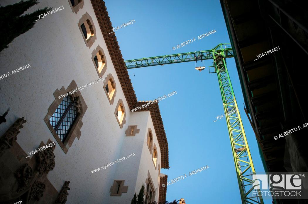 Stock Photo: Church of San Bartolome and Santa Tecla, crane used for restoration. Sitges, Barcelona, Spain.