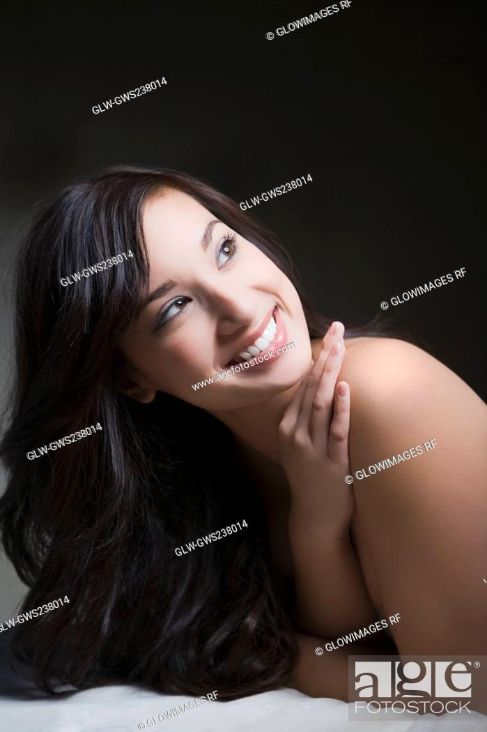 Stock Photo: Close-up of a young woman lying on a massage table and smiling.