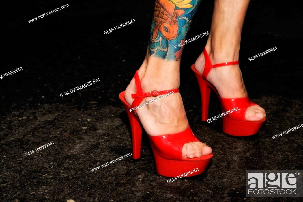 Stock Photo: Close-up of a woman's legs wearing stiletto.