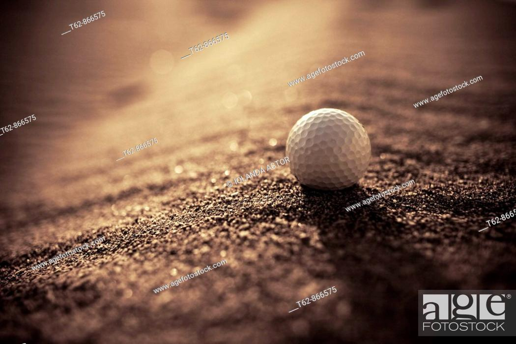 Stock Photo: Golf ball in the sand  Foreground.