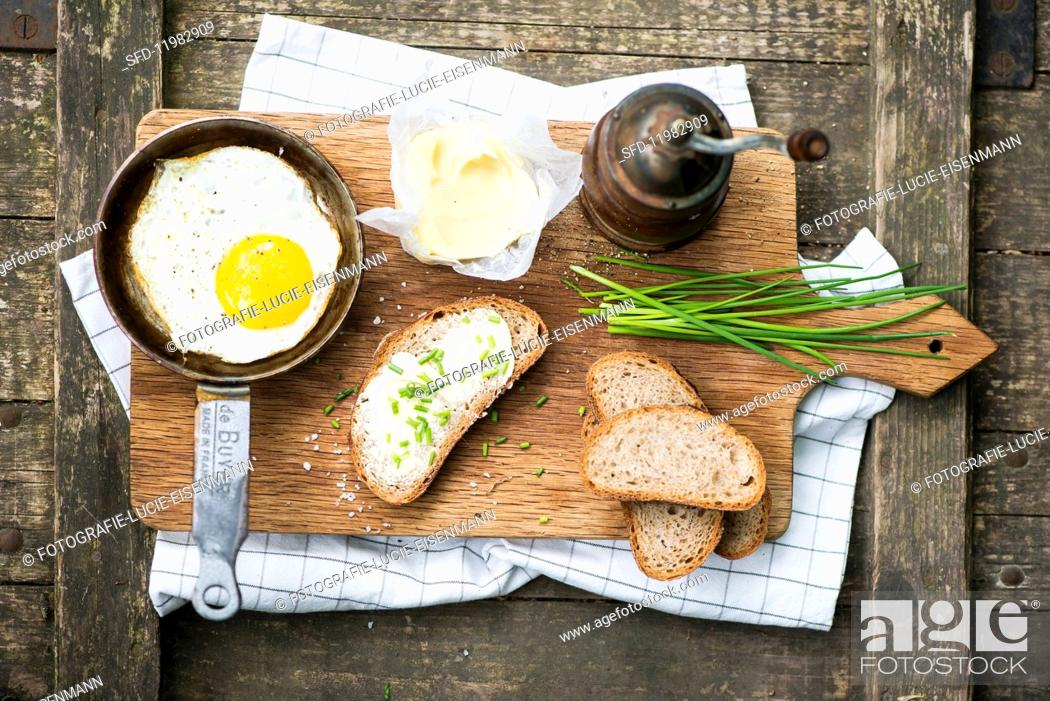 Stock Photo: Fried egg with chive bread.