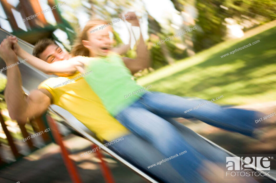 Stock Photo: Father and daughter on slide.