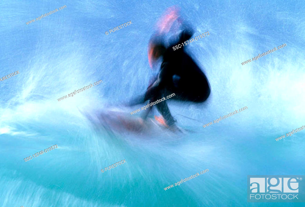 Stock Photo: Silhouette of a person surfing in the sea.