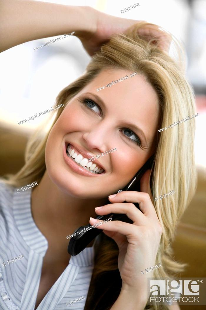 Stock Photo: Young woman using cell phone.