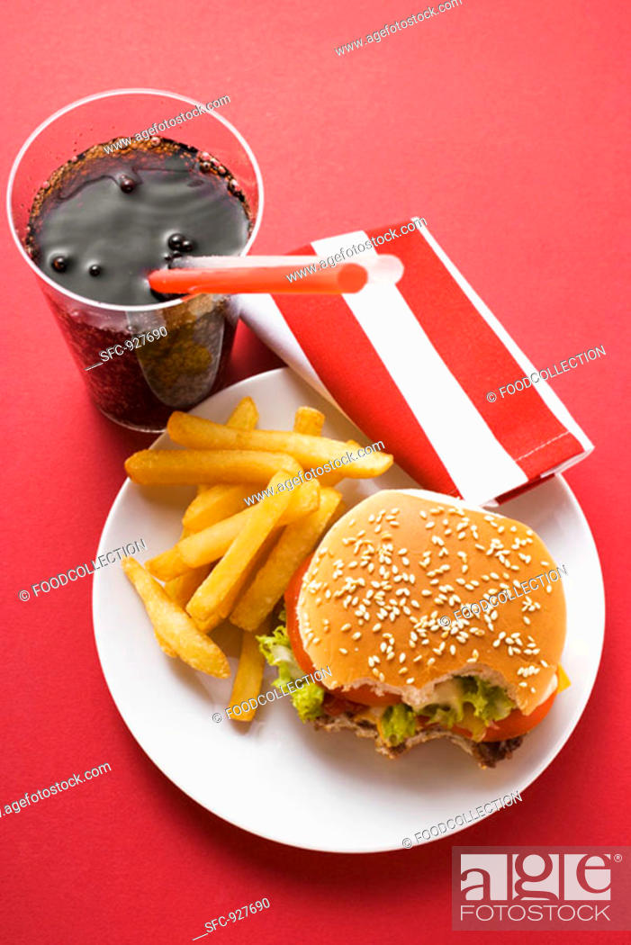Stock Photo: Cheeseburger, bites taken, with chips and Cola.
