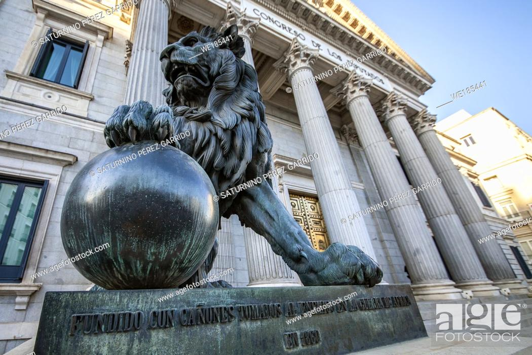 Stock Photo: Congress building of the deputies of Spain, with a statue of two lions that for its creation was with the Cast of cannons taken to the enemy in the War of.