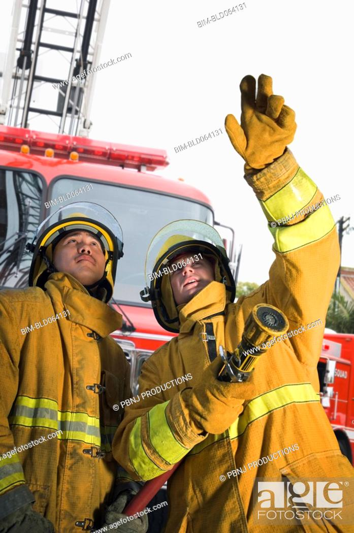 Stock Photo: Firefighters putting out fire.