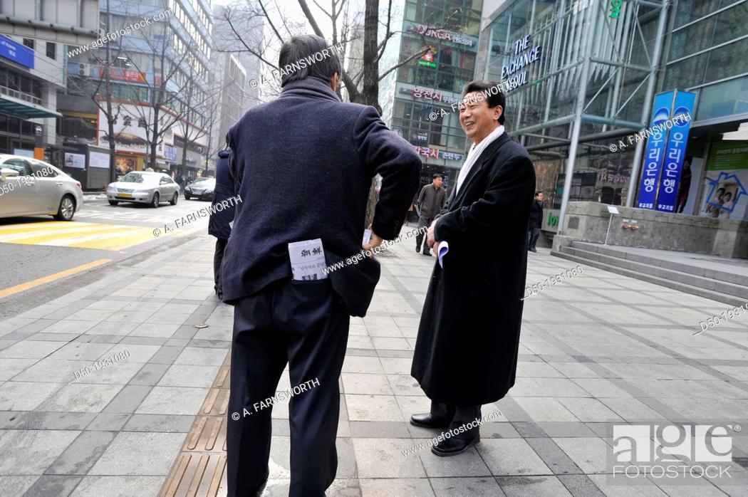 Stock Photo: SEOUL SOUTH KOREA Downtown guys speaking.