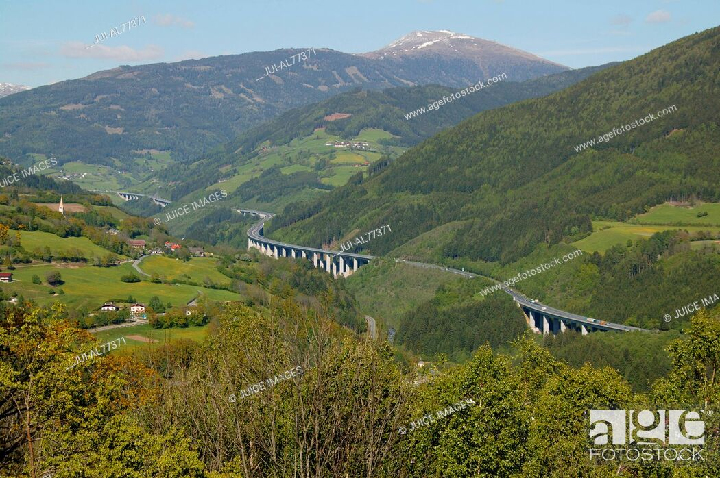 Stock Photo: Aerial view of Tauern-motorway winding through rural valley, Gmuend, Kaernten, Austria.