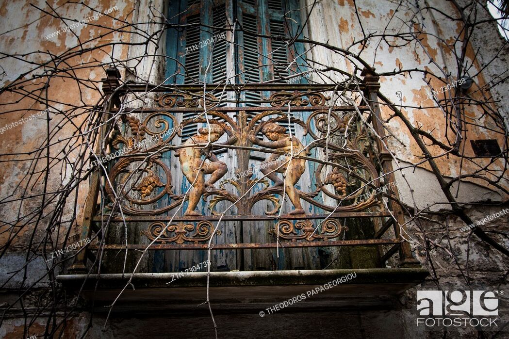 Stock Photo: The balcony railing of an abandoned house at Tripoli city. Arcadia, Peloponnese, Greece.